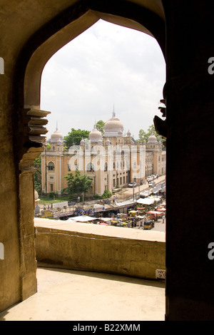 Looking out of an arch from the Charminar in Hyderabad, India. - Stock Photo