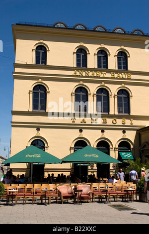 The Tambosi cafe in Munich, Germany. Located on Odeonsplatz, this is a place to watch people and to be seen. - Stock Photo