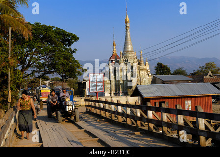 Tractor on wooden bridge Nyaung Shwe Shan State Myanmar - Stock Photo