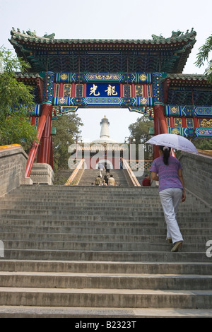 Group of people climbing stairs of pagoda White Dagoba Temple Beijing China - Stock Photo