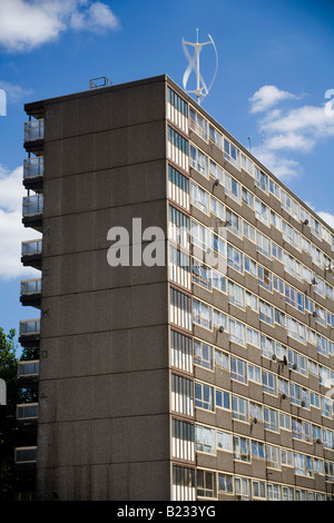 Vertical Axis Wind Turbine on top of a Council Estate tower block in South London England Britain UK - Stock Photo