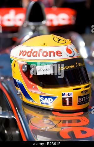 Formula 1Lewis Hamilton helmet on mclaren car - Stock Photo