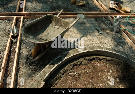 Wood forms, rebar and a masonry to form a step to a backyard patio of a private home in California. - Stock Photo
