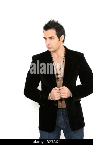 Good looking young male fashion model against a white background - Stock Photo