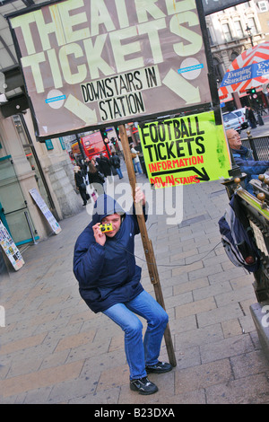 a man with a sandwich board in london - Stock Photo