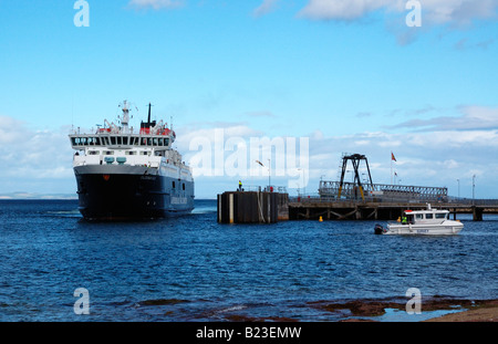 The Docking of the CALMAC ferry at the Lochranza ferry terminal on the Isle of Arran, Scotland - Stock Photo