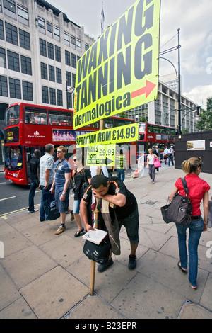 man with a sandwich board in london - Stock Photo