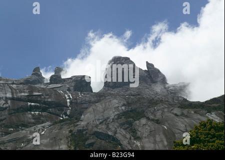 Clouds pouring off summit rocks seen from Laban Rata Mt Kinabalu Sabah Malaysia - Stock Photo