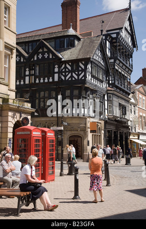 Shoppers in Eastgate Street pedestrianised precinct in city centre. Chester Cheshire England UK Britain - Stock Photo