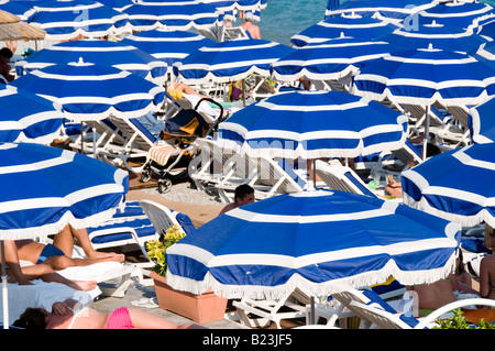 Parasols on the beach of Anges Bay, Nice, France - Stock Photo