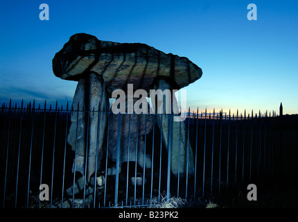 Kit's Coty, a Neolithic chambered tomb in Kent, England, lit with blue light, and seen against a blue sky just after - Stock Photo