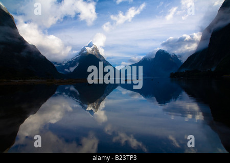 New Zealand Southland Fiordland National Park A clearing storm above Mitre peak reflected in the Milford Sound - Stock Photo