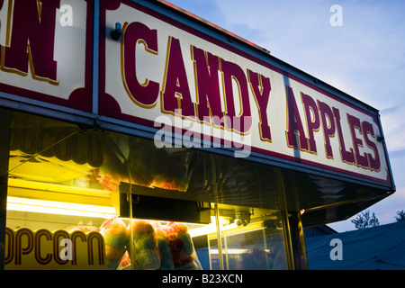 Concession stand with candy apples and popcorn at county fair - Stock Photo