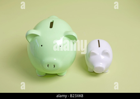 two piggy banks, one large and one small - Stock Photo