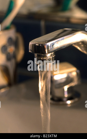 WATER RUNNING FROM FAUCET - Stock Photo