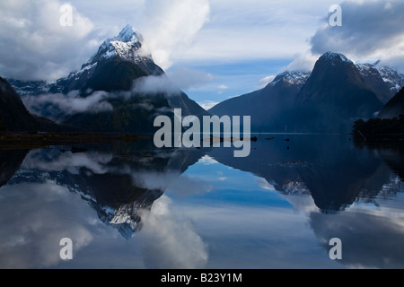 New Zealand Southland Fiordland National Park A clearing storm above Mitre peak reflected in the waters of the Milford - Stock Photo