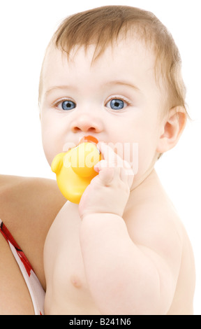 picture of blue eyed baby boy with rubber duck - Stock Photo