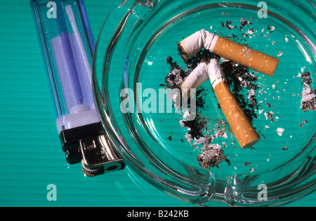 Disposable lighter and ashtray. - Stock Photo