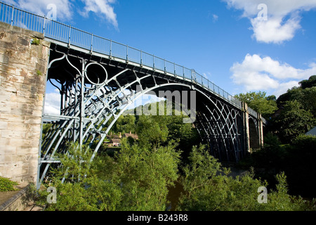 Worlds first iron bridge spans the banks of the River Severn in late evening summer light Ironbridge Shropshire - Stock Photo
