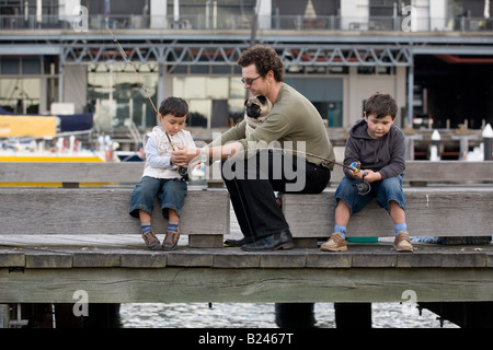 Father and Sons Fishing Pyrmont Point Park Sydney New South Wales Australia - Stock Photo