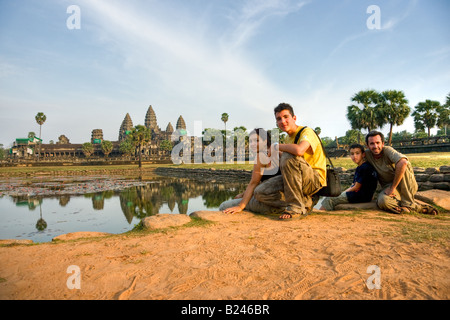 Family visiting Angkor Wat Temple at sunset Siem reap Cambodia - Stock Photo