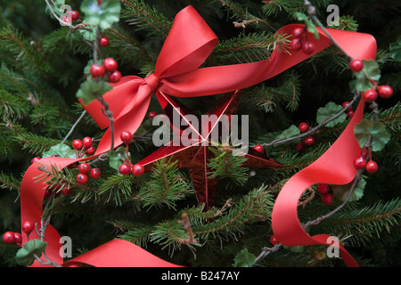 Christmas decorations on a tree - Stock Photo