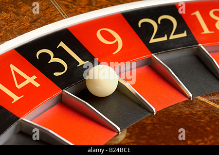 Roulette wheel and ball - Stock Photo