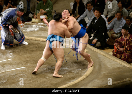 Two Sumo Wrestlers in competition - Tokyo, Japan - Stock Photo