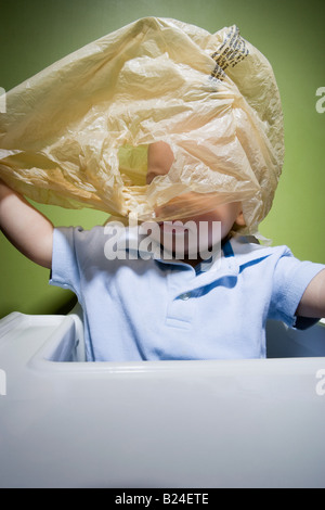 Baby in danger with plastic bag - Stock Photo