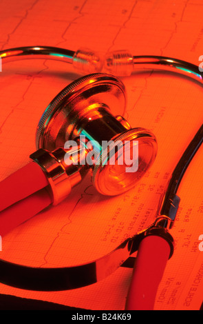 RED STILL LIFE STETHOSCOPE SOUND DETECTION DEVICE, OFTEN USED DURING MEDICAL EXAMS TO LISTEN TO HEART BEATS AND - Stock Photo