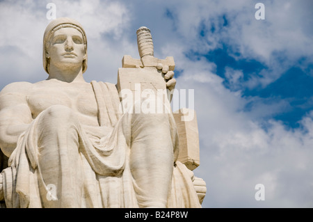 The statue called The Authority of Law at the entrance to the US Supreme Court in Washington DC - Stock Photo