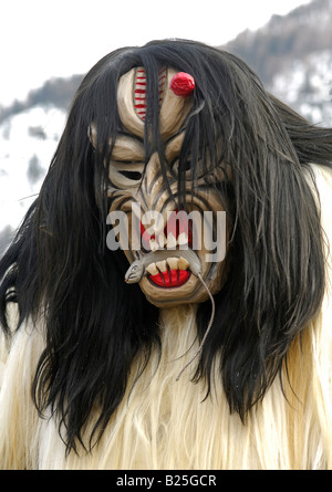 Mouse eating Tschaeggaetae mask bearer, Carnival masks, Wiler Loetschental, Valais, Switzerland - Stock Photo