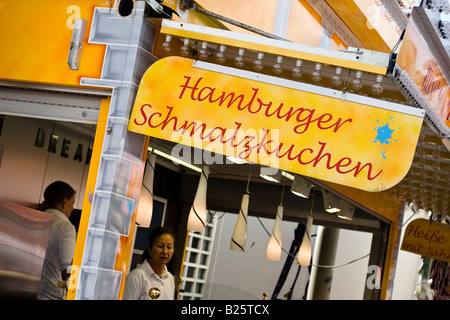 Sign advertising Schmalzkuchen a local culinary speciality at Hafengeburtstag a street party in the harbour of Hamburg, - Stock Photo