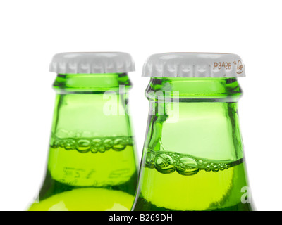 Bottles Of Unopened Stella Artois Lager Beer Isolated Against A White Background With A Clipping Path And No People - Stock Photo