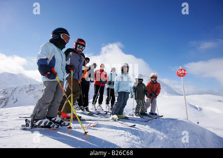 Children and adults on slope, Stuben, Arlberg, Tyrol, Austria - Stock Photo
