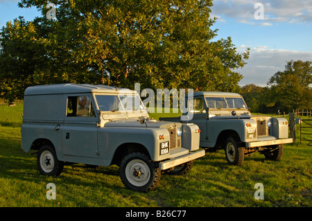 AppleMark A matching couple of two historic 1963 Landrover Series 2a's on a farm in Dunsfold, UK 2004. - Stock Photo