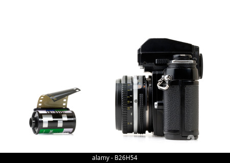 35mm film camera and roll of slide film - Stock Photo