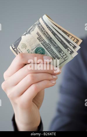 Money in woman's hand - Stock Photo
