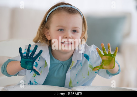 Girl finger painting with different colors - Stock Photo