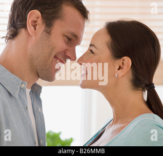 Hispanic couple smiling at each other - Stock Photo