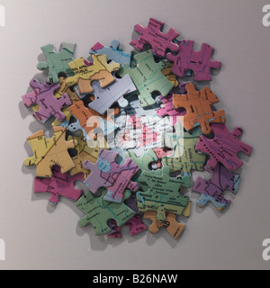 jigsaw map of Britain  surrounded by pieces - Stock Photo