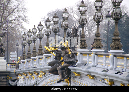 France, Paris, Lamp posts and statues on Pont Alexandre III - Stock Photo