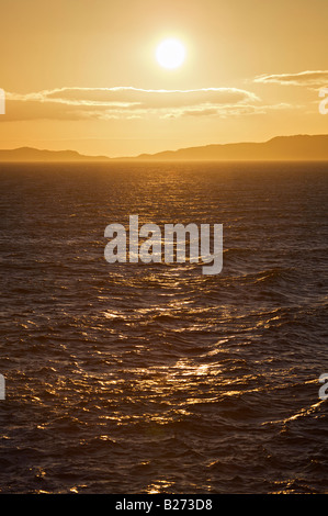 Golden sunset across the North Minch to Lewis and Stornoway - Stock Photo