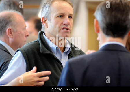 Royalty free photograph of a British business men in meeting talking and networking in corporate offices London - Stock Photo