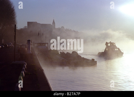 Misty morning on the Seine bank in Conflans Sainte Honorine - Stock Photo