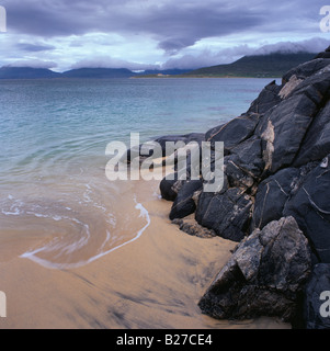 Wave lapping the beach at Horgabost on the Isle of Harris, Western Isles, Scotland - Stock Photo
