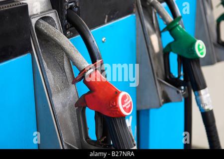 Petrol pump nozzles UK - Stock Photo