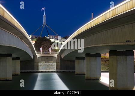 Australian Parliament House with Flagpole seen through Commonwealth Avenue Bridge over Lake Burley Griffin, Canberra. - Stock Photo