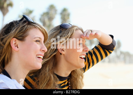 Two young women with sunglasses on head - Stock Photo