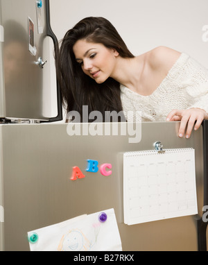 Woman looking in refrigerator Stock Photo
